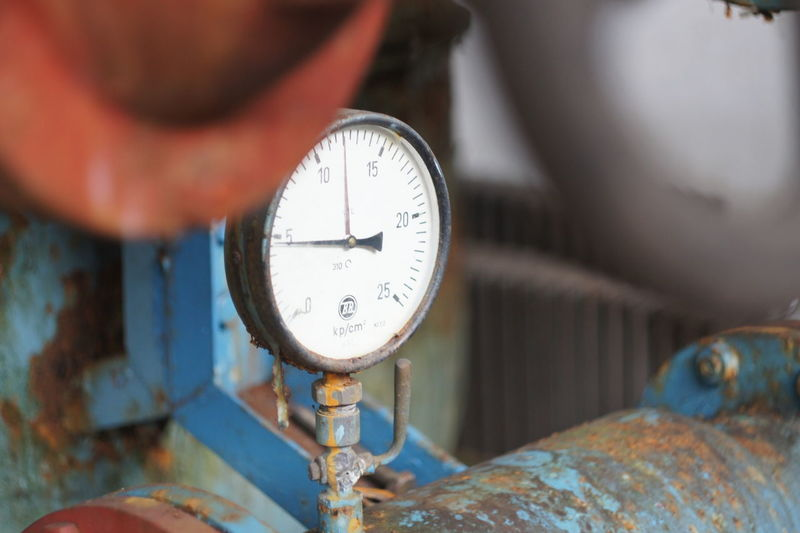 Close-up of gauge on machinery
