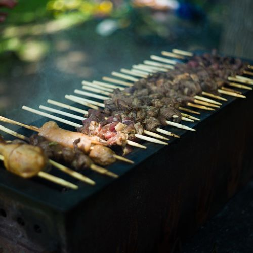 High angle view of kebabs on barbecue grill