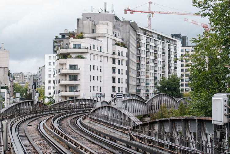 Architecture Building Exterior Built Structure City Day Mode Of Transport No People Outdoors Rail Transportation Railroad Track Sky Train - Vehicle Transportation Tree Stories From The City