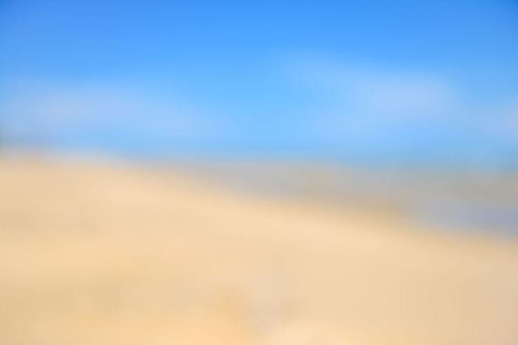 Defocused image of landscape against blue sky