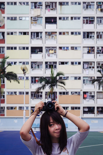 Young Female Photographer In A Residential District