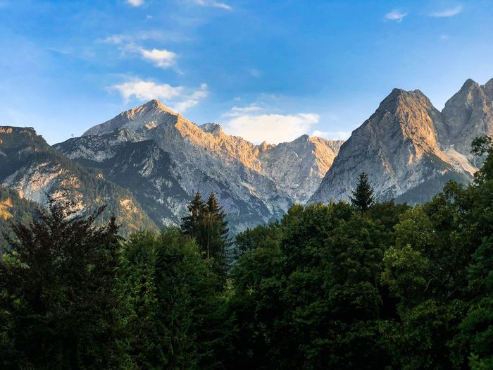 Alpspitze and Waxenstein at sunset Sunset Mountain Sunset Mountain Sky Beauty In Nature Scenics - Nature Mountain Range Tranquil Scene Tree Mountain Sky Beauty In Nature Scenics - Nature Mountain Range Tranquil Scene Tree Plant Tranquility Cloud - Sky Non-urban Scene Environment Landscape No People Nature Idyllic Land Day Green Color Growth
