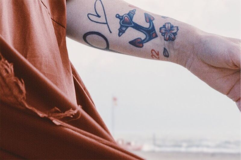 Close-up of hand with tattoo