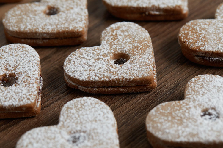 Close up of freshly baked homemade Christmas sugar cookies with jam Food Food And Drink Indoors  Close-up Baked Sweet Food No People Freshness Wood - Material Studio Shot Wellbeing Selective Focus Large Group Of Objects Still Life Group Of Objects Indulgence High Angle View Abundance Sweet Homemade Temptation Breakfast Homemade Freshness Jam Freshly Baked Freshly Cookies Cookie