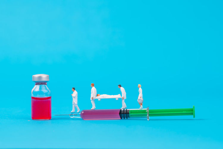 miniature people healthy team and medical drug,medical concept Doctor  Drug Hospital Injection Medicine PainKiller Teamwork Therapy Vial Antibiotic Equipment Figurine  Healthcare And Medicine Miniature People Needle Patient Pill Small Syringe Tool Treat