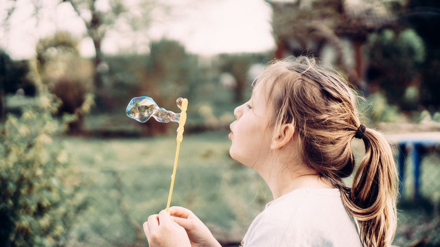 Portrait of girl holding bubbles