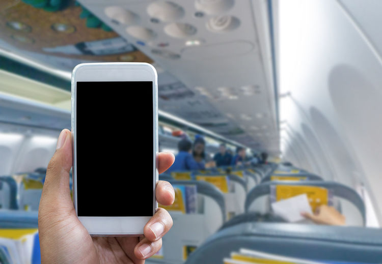 Man use your phone in airplane blurred background - mockup template Airplane Using Blank Closeup Shoulders Guy Iphon Aircraft Phone Jet Transportation Plane Trip Travelling Cabin Business People Flight Communicate Air Texting Tablet Telephone Male Digital Cellular Technology Computer Equipment Behind Mobile Touchscreen Smartphone Device Wireless Wireless Technology Smart Phone Mobile Phone Communication Using Phone
