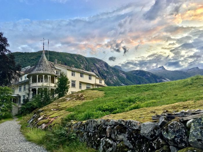 Hotel Victorian Norway Architecture Beauty In Nature Building Building Exterior Built Structure Cloud - Sky Environment Grass Green Color House Land Landscape Mountain Mountain Range Nature No People Outdoors Plant Residential District Scenics - Nature Sky