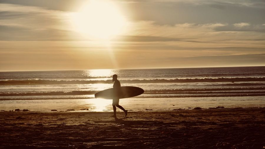 All eyes on me !!! California Sunrise Sea Beach Sunset Horizon Over Water Water Scenics Beauty In Nature Sky Silhouette Tranquil Scene Leisure Activity Nature Tranquility Full Length One Person Real People Sun Sunlight Sand Shore