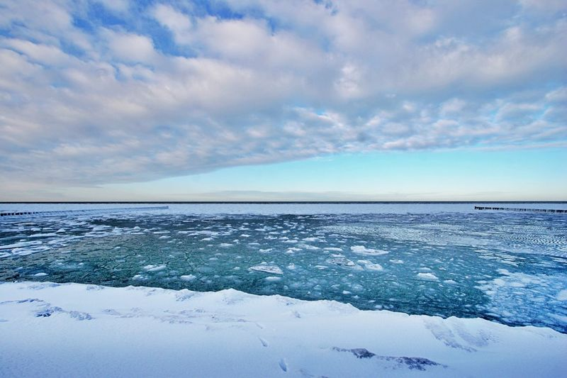 Sky Cloud - Sky Winter Cold Temperature Scenics - Nature Tranquil Scene Tranquility Horizon No People Water Snow Day Horizon Over Water Environment Outdoors Sea Ice Nature Blue