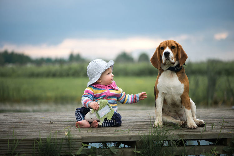 Baby Dogs Animal Themes Baby Girl Beagle Beauty In Nature Best Friend Childhood Day Dog Domestic Animals Full Length Lake Leisure Activity Mammal Nature One Animal One Person Outdoors People Pets Real People Sitting Sky Water Be. Ready.