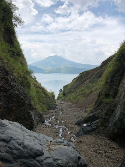 Lake toba Sky Water Cloud - Sky Beauty In Nature Mountain Scenics - Nature Tranquility Tranquil Scene Nature Day Land No People Non-urban Scene Rock Plant Outdoors Idyllic Tree Solid Beach