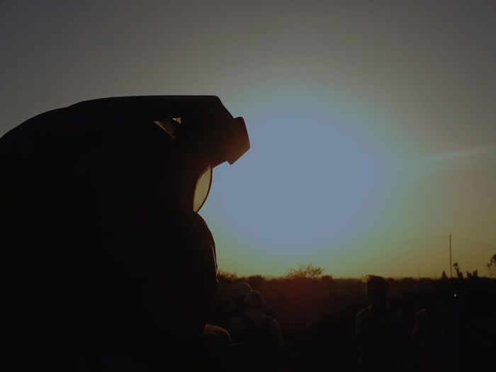 Side view portrait of silhouette man standing against sky during sunset
