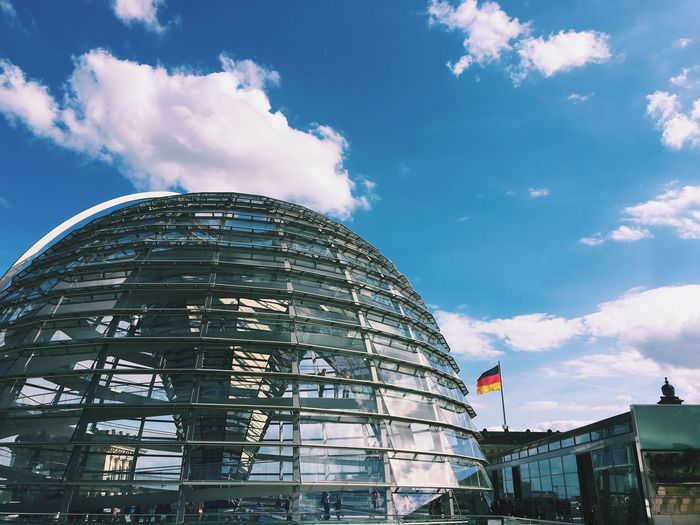Low angle view of reichstag against blue sky in city