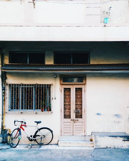 EyeEmNewHere Bicycle Transportation Mode Of Transport Cycling Architecture Building Exterior Land Vehicle Window No People City Day Built Structure Stationary Outdoors 10