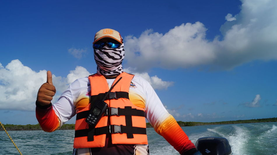 all profits of this picture would be shared with the skipper :-) Holidays Quintana Roo Thumbs Up ! Boat Ride Cloud - Sky Day Front View Guided Tour Horizon Over Water Mask Mexiko Nature One Person Outdoors Real People Sea Sky Standing Sunglasses Thumbs Up Water