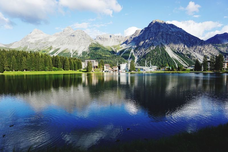 Arosa Obersee reflection Arosa Graubünden Switzerland EyeEm Selects Mountain Water Sky Reflection Cloud - Sky Beauty In Nature Scenics - Nature Lake Tranquility Nature Tranquil Scene Day Mountain Range Plant Waterfront Tree Architecture No People Idyllic Stay Out My Best Photo