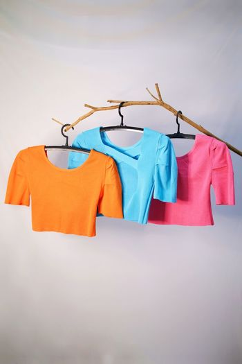 Low angle view of clothes drying against white background