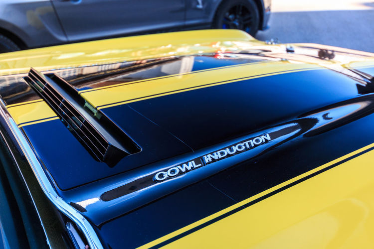 Chevrolet Chevelle Mode Of Transportation Transportation Car Land Vehicle Motor Vehicle Yellow No People Day Close-up Blue Outdoors Stationary Focus On Foreground High Angle View Taxi Luxury Travel Reflection Black Color Wealth Consumerism Cuda Chevrolet Chevelle