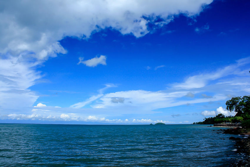 Sea View Clouds in the Sky on a Bright Day Beauty In Nature Blue Cloud - Sky Day Horizon Horizon Over Water Idyllic Land Land With Sea Landscape Landscape Sea Landscapes Landscapes With Sea Nature No People Non-urban Scene Outdoors Scenics - Nature Sea Sky Tranquil Scene Tranquility Water Waterfront