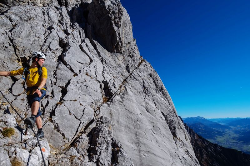 Enjoying sunny weather in a Via Ferrara at Ellmauer Halt, Austria 🇦🇹 Adventure One Person Rock Climbing Day Climbing Low Angle View Outdoors Rock - Object Leisure Activity Mountain Nature Climbing Rope Real People One Man Only Sport RISK Clear Sky Men Go Higher