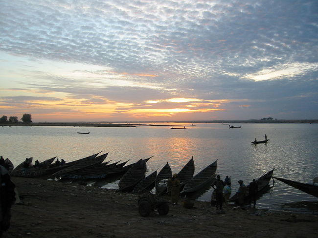 """Pinnasse"" on Niger river at Mopti Beauty In Nature Mopti Niger River Outdoors Pinasse Riverside Sky Sunset Tranquility Water"
