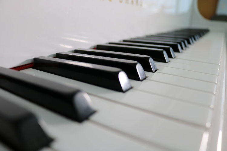 White grand piano keys close up Beethoven Music Piano Sound Arts Culture And Entertainment Black Color Classical Close-up Diminishing Perspective High Angle View In A Row Indoors  Keyboard Keyboard Instrument Music Musical Equipment Musical Instrument No People Pattern Piano Piano Key Playing Selective Focus Still Life White Color