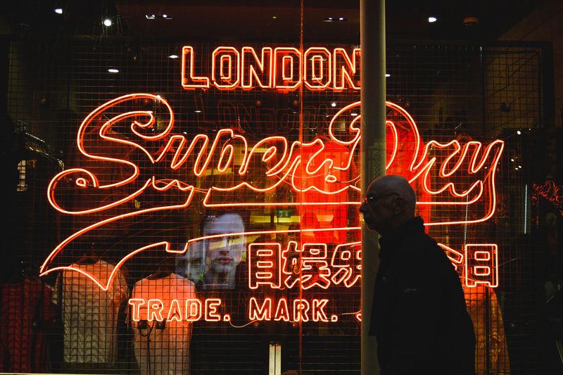 Information sign on illuminated store at night