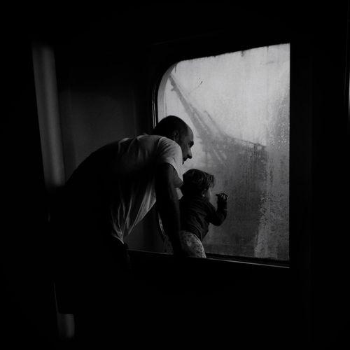 Man sitting in window