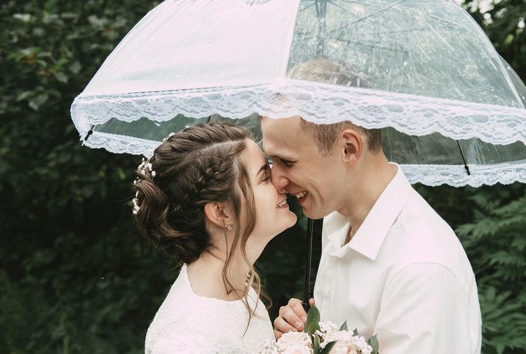 Close-up of female friends with umbrella