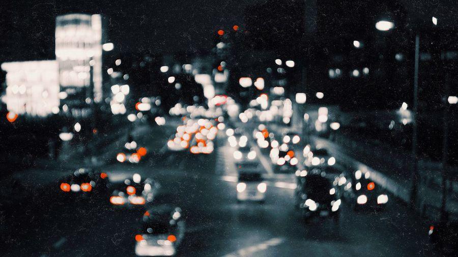 Defocused image of traffic on road at night