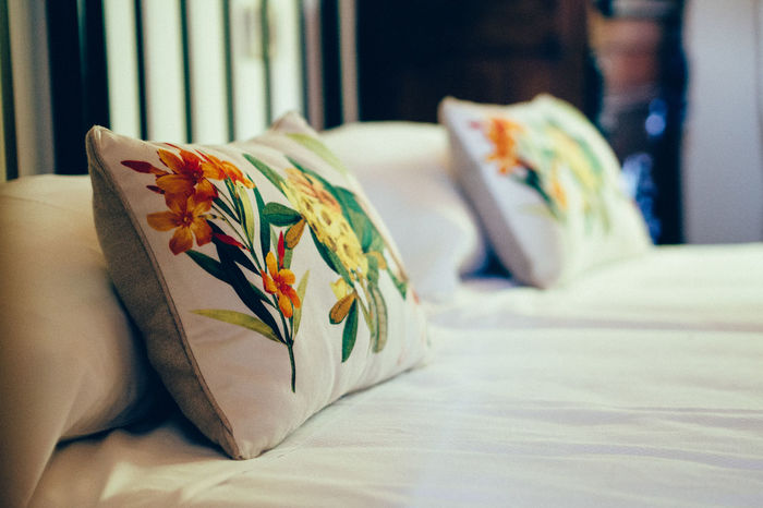 flowers on bed Bed Bedroom Close-up Comfortable Day Domestic Room Fabric Flowers Focus On Foreground Furniture Home Home Is Where The Art Is Interior Design No People Pillow Relaxation Resting Selective Focus Sheet Softness Textile White