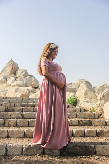 Dubai Greek Maternity Maternity Shoot Portrait Of A Woman UAE UAE , Dubai Built Structure Concept Day Dubaicity Full Length Lifestyles Nature One Person People Photo Portrait Portrait Of A Lady Real People Rock - Object Standing Young Adult Young Women