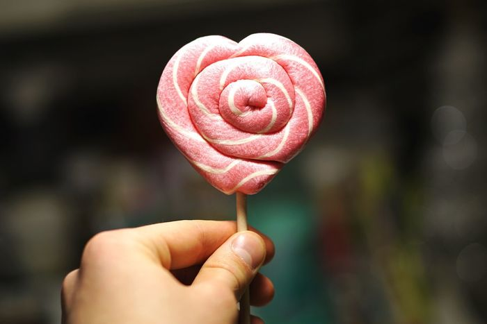 Holding Pink Color Human Hand Food Heart Shape Candy Lollipop Sweet Sweet Food Sugar Handmade Fresh On Market 2017