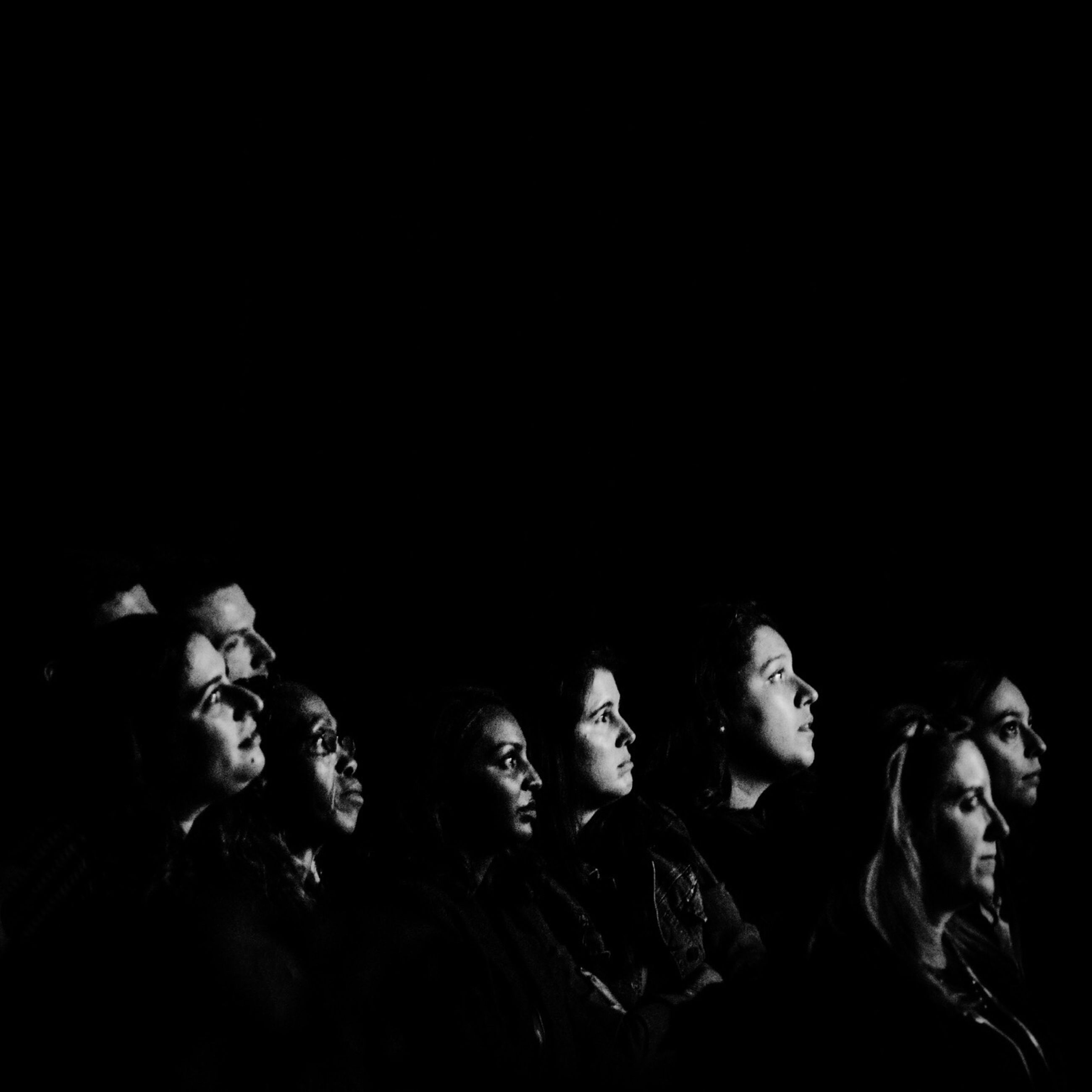 lifestyles, leisure activity, togetherness, men, black background, night, indoors, young adult, studio shot, copy space, young men, standing, dark, person, bonding, front view