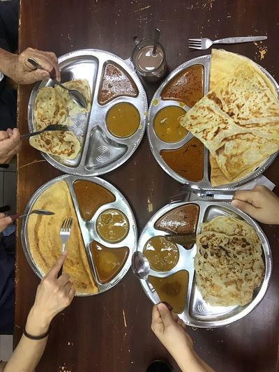 Eyeem Market EyeEmNewHere EyeEmBestPics EyeEm Best Shots Typical Breakfast Malaysian Culture Malaysian Food Foodie Roti Canai And Curries Roti Canai Human Hand Hand Human Body Part Real People Food And Drink One Person Holding Ready-to-eat #FREIHEITBERLIN
