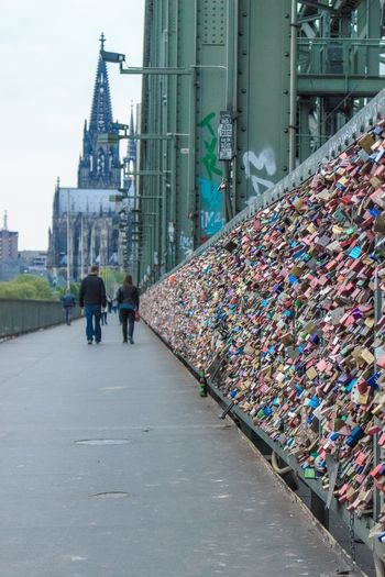 The city. Architecture Built Structure Love Lock Padlock Day Love Outdoors Real People Building Exterior Bridge - Man Made Structure Men City Sky People Mobility In Mega Cities Colour Your Horizn