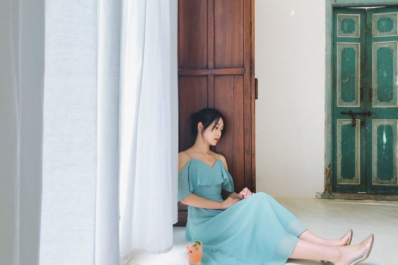 Greendress Graceful Chiangmai PhonePhotography One Person Real People Young Adult Leisure Activity Relaxation Sitting Lifestyles Casual Clothing Indoors  Anticipation Beautiful Woman
