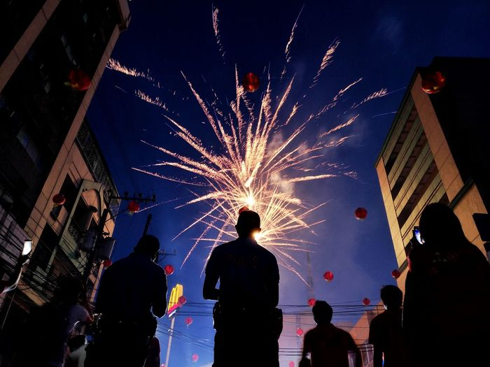 The Week on EyeEm EyeEm Best Shots Illuminated Multi Colored City Firework Display Celebration Silhouette Firework - Man Made Object Arts Culture And Entertainment Exploding Holiday - Event Entertainment Firework Sparks HUAWEI Photo Award: After Dark