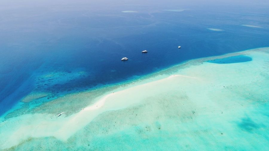 Sandbank between blue and turquoise. #maldives #sandbank #ocean #travel Water Sea Tranquility Beauty In Nature Blue Land High Angle View Scenics - Nature Nature Tranquil Scene Aerial View Idyllic Sand Outdoors Non-urban Scene No People Turquoise Colored Lagoon Beach Day