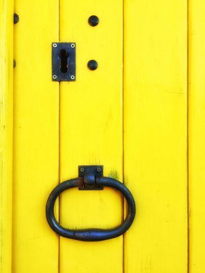 Close-up of yellow door