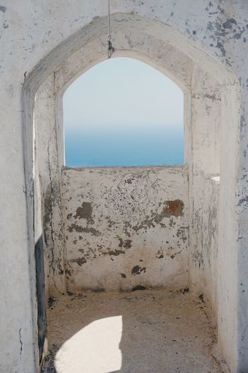Church tower Arch Day Architecture Built Structure Sunlight Window Clear Sky Sea No People Sand Sky Beach Nature Water Indoors  View Chuch White Whitewashed Greece Nikia Greek Islands Nisyros Whitewall Whitewashed Houses
