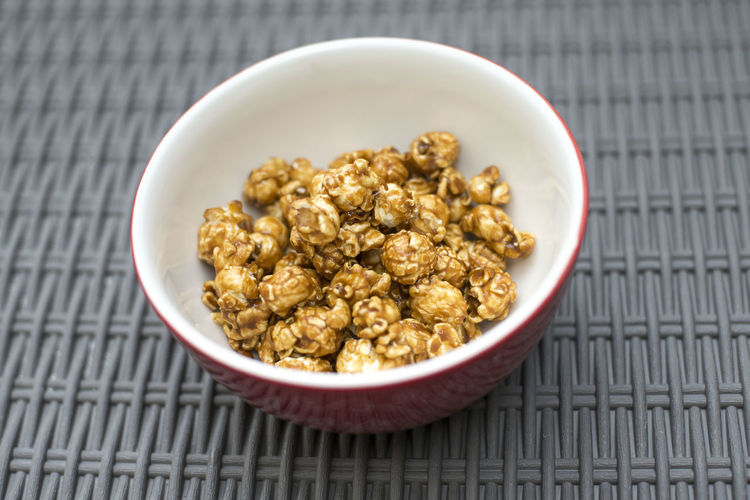 Close-up of caramel corn in bowl on table