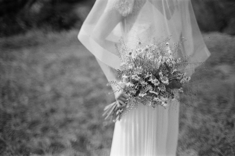 Wedding Flower Flowering Plant Newlywed Bride Focus On Foreground Plant Wedding Dress Women Adult Event Celebration Life Events Nature Day Standing Flower Arrangement Field Bouquet Midsection Outdoors Veil Flower Head Daisy Flower Daisy Wedding Photography Wedding Ceremony Wedding Day Blackandwhite Black And White Film Film Photography Filmisnotdead