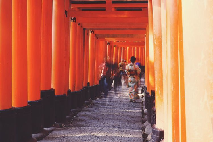 I spent a good twenty minutes waiting for the pathway to clear so I could take my photo; which in retrospect is a futile endeavour during tourist season. Overwhelmed by mosquito bites I switched over to a 5-second exposure, and I'm pretty happy with the result. ASIA Japan Path Wanderlust Architecture Built Structure Fujifilm Fushimi Inari Shrine In A Row Kimono Kyoto Orange Color Outdoors People Place Of Worship Religion Spirituality The Way Forward Travel Destinations