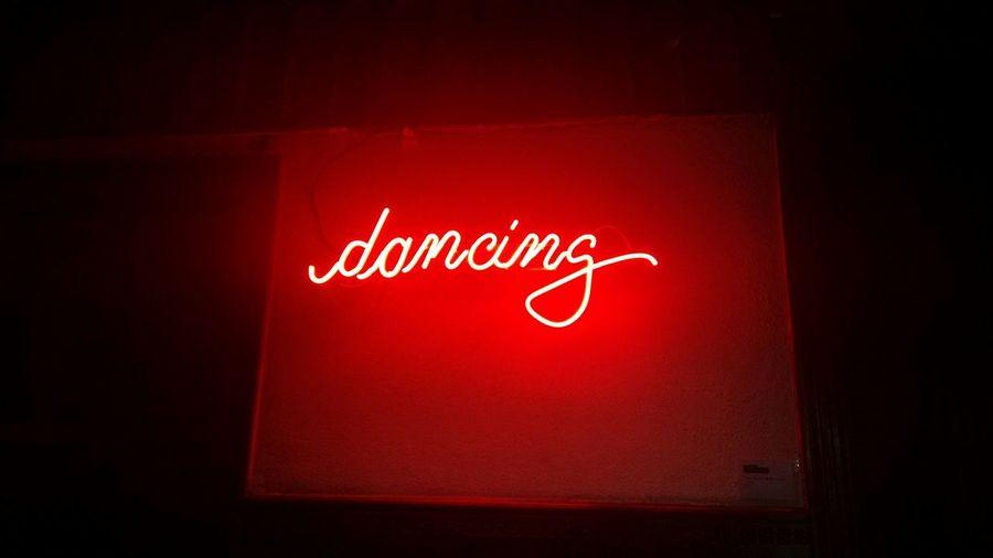 Neon Lighting Word Dancing In Red