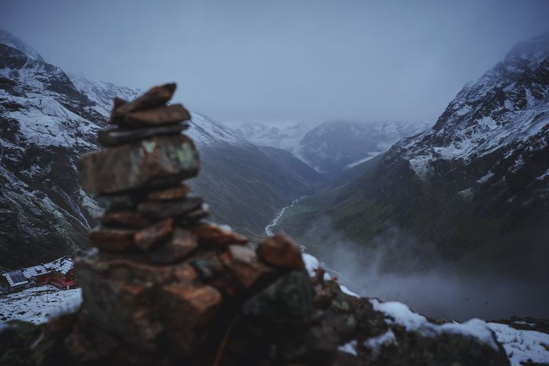 Hiking - Cairn in the mountains Fog Rough Mood Live Authentic Hiking Cairns Cairn Mountain Snow Nature Winter Cold Temperature Rock - Object Beauty In Nature No People Tranquil Scene Mountain Range Scenics Tranquility Outdoors Landscape Day Sky