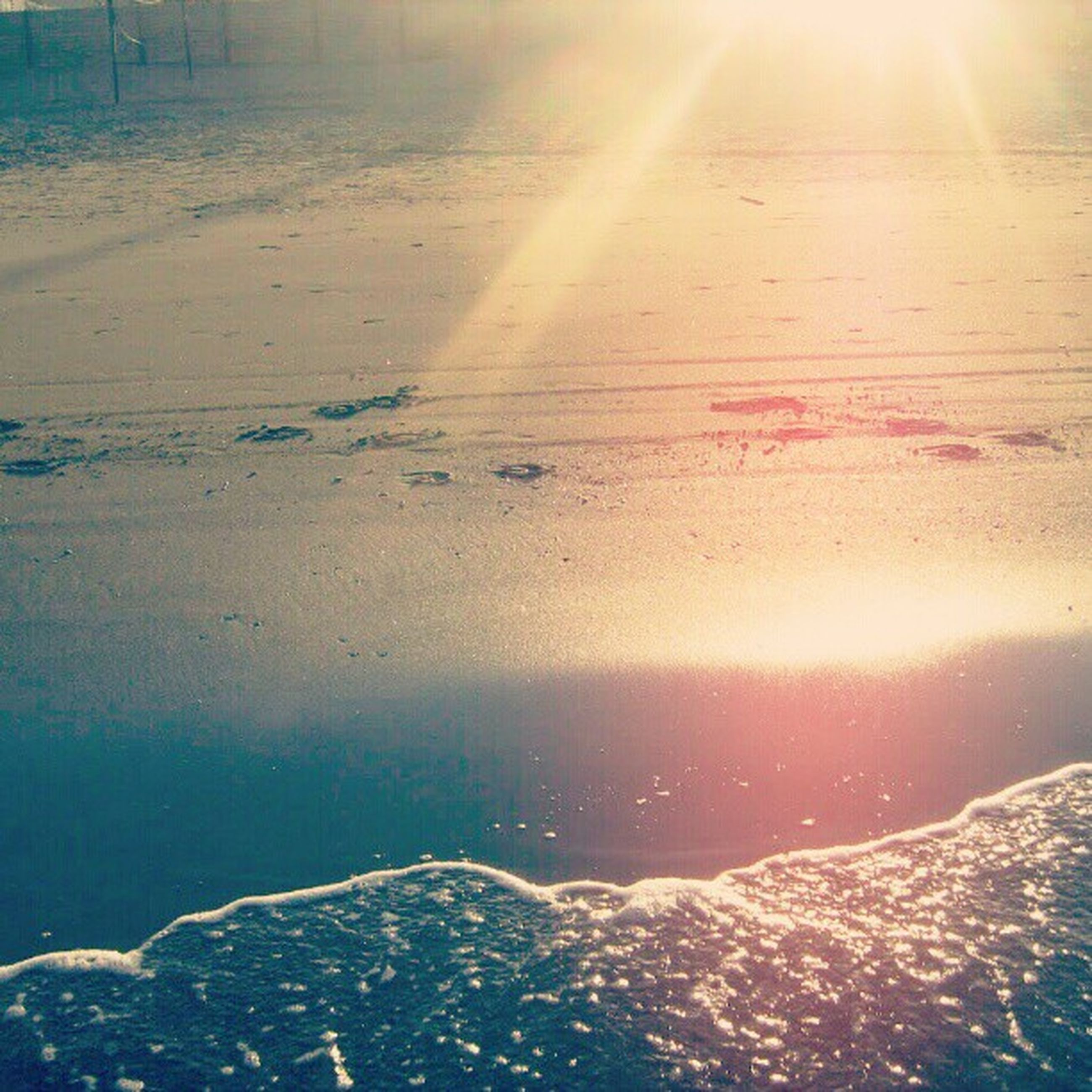 scenics, tranquility, water, tranquil scene, beauty in nature, sea, sun, nature, beach, sunlight, sunbeam, idyllic, sand, shore, lens flare, aerial view, non-urban scene, sky, landscape, outdoors