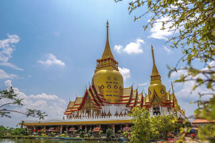 Wat Phrong-Akat (The buddhist temple in Chachoengsao district, Thailand) Jedi Thailand Wat Temple Chachoengsao City Gold Place Of Worship Spirituality Tree Ancient Religion Business Finance And Industry Golden Gold Colored Praying Buddha Monument