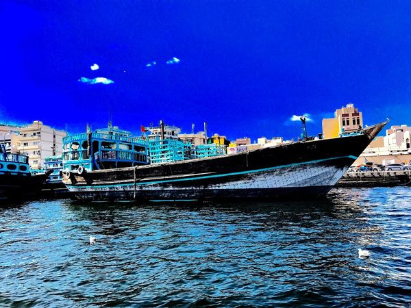 Dubai❤ Nautical Vessel Water Transportation Mode Of Transport Blue Moored Architecture Sea Waterfront No People Outdoors Built Structure Day Nature Building Exterior Sky City